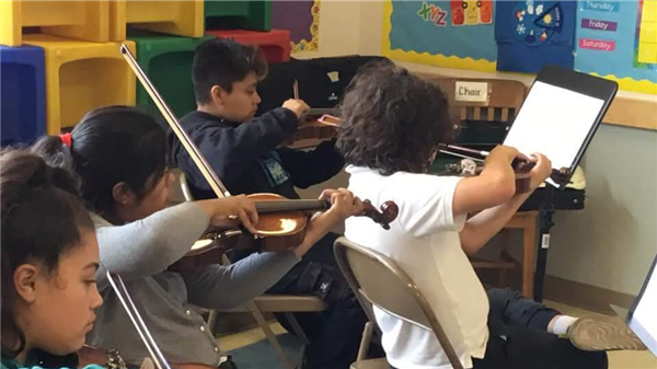 Bellevue Students practicing violin